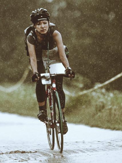 bad-add-chick-riding-road-bike-rain